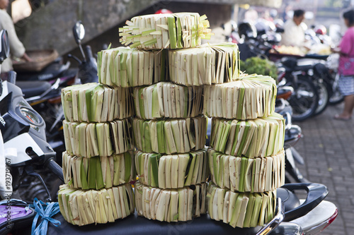 Tuinposter Bali Woven bamboo stacked at an outdoor market in Bali