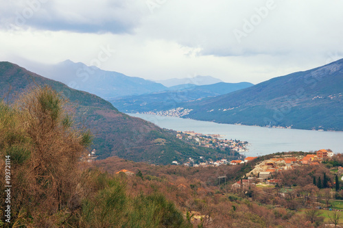 Poster Cappuccino Mediterranean landscape on a cloudy winter day. Montenegro, view of Bay of Kotor near Herceg Novi city
