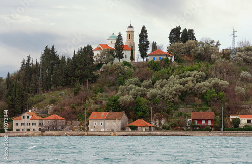 Aluminium Wit Church on hill. Montenegro, view of Church of Sveta Nedjelja in Kamenari town