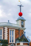 Red time ball on top the octagon room of the Royal Observatory in Greenwich - 193745744