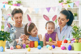 family are painting eggs - 193757503