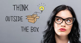 Think Outside The Box with young businesswoman in a thoughtful face - 193757737