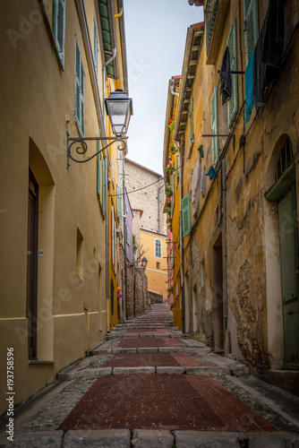 Fotobehang Smalle straatjes Rainy streets of the French city of Menton