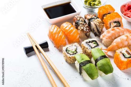 Foto Spatwand Sushi bar Sushi and sushi roll set on white background.