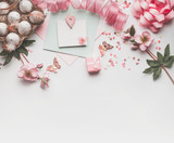 Modern styled Easter background with pastel color decoration: eggs, ribbon, flowers, bow and gift box. Mock up for Easter greeting card on white desk background, top view - 193788976