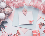 Lovely Easter greeting card on pastel color , mock up with eggs  ribbon, gift box and decoration, top view - 193788986