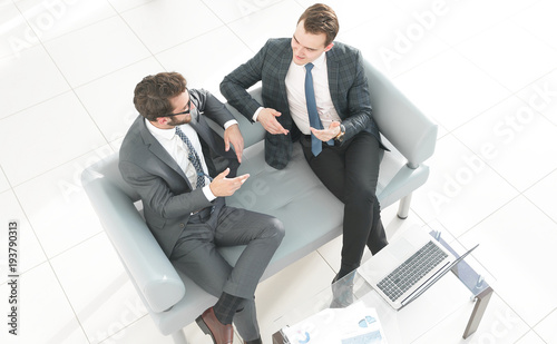business partners discussing a contract