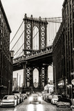 Manhattan Bridgeas seen from Washington street in Brooklyn, New York City, USA. Motion blured jogger running in foreground. Black and white image. - 193794988