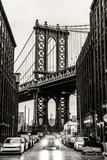 Manhattan Bridgeas seen from Washington street in Brooklyn, New York City, USA. Motion blured jogger running in foreground. Black and white image. - 193794988