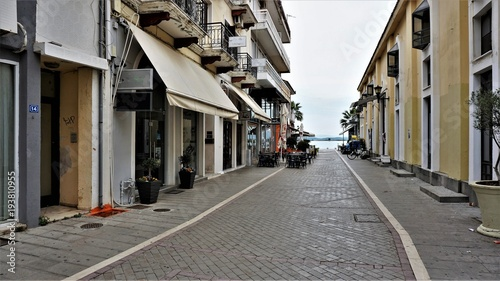 Fototapeta Street in the town of Preveza, Greece. This interesting street leads to the port of Preveza. Photos of the year 01.05.2016 was filmed.