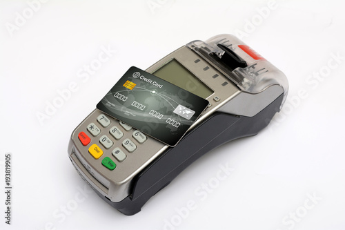 Credit debit card on top of reader machine isolated