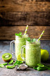 green smoothie with spinach, apple, kiwi, lime and chia seeds. healthy diet eating, superfood