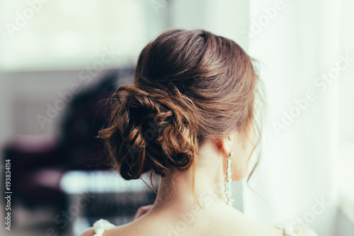 Foto op Canvas Kapsalon Beautiful young bride with wedding makeup and hairstyle. Happy Bride waiting groom. Bride portrait soft focus
