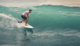 Surfer on Blue Ocean Wave, Bali, Indonesia. Riding in tube. - 193836701