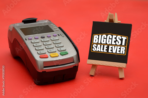 Biggest Sale Ever Sign with Credit Card swipe machine