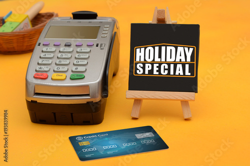 Holiday Special sale sign with credit card swipe machine