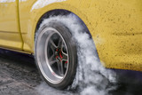 Drag racing car burns rubber off its tires in preparation for the race - 193847913