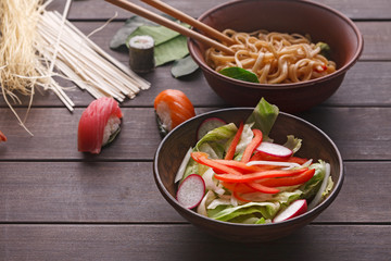 salad with onion, pepper and radish on wooden background