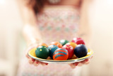 Attractive woman painting Easter eggs at home - 193853339