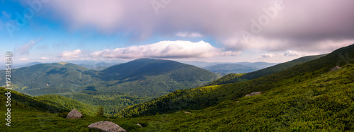 Foto op Canvas Bleke violet panorama of beautiful mountain landscape. beautiful scenery with clouds coming over the hills