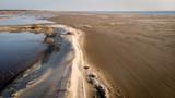 vol au dessus d'une dune qui sépare un étang et la plage avec la mer au fond - 193868766