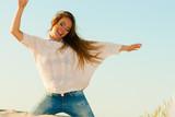 Young joyful girl on beach.