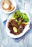 Grilled Pork Steak with Mediterranean-style Salad - 193880345