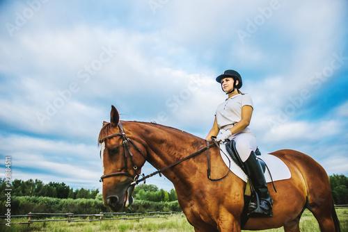 Girl jockey riding a horse