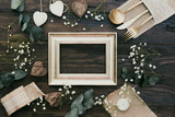 Details of a rustic wedding with gold frame over wooden background. Flat Lay, Top View, Copy Space - 193889134