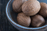 Whole Nutmeg in Blue Pottery Bowl - 193896531