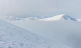 Горы зимой с облаками - 193898534