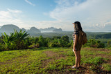young traveler backpacker looking forward at sun to see landscape view of mountain at sunrise time,Freedom wanderlust,Khao Samed Nang Chee Viewpoint,Phang Nga,Thailand