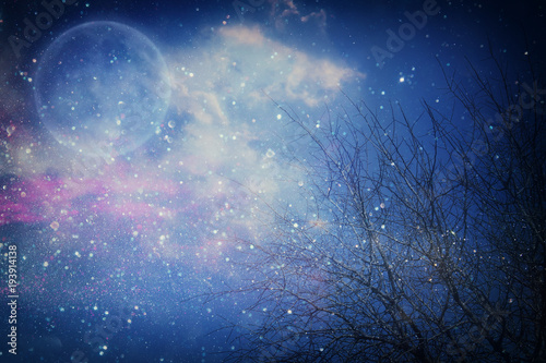 Surreal fantasy concept - full moon with stars glitter in night skies background. © tomertu