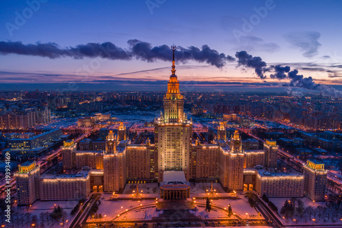 Tuinposter Moskou Illuminated Moscow State University at Frosty Winter Evening. Aerial View.