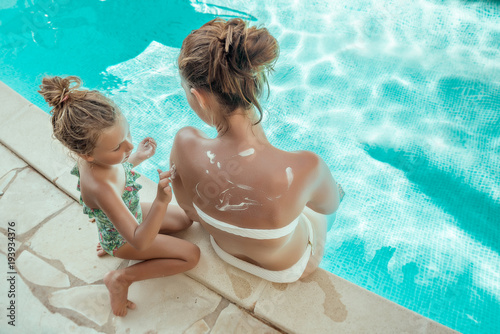girl with mother sunbathing