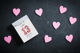 Tear-Off Calendar with Mothers's Day 2018 on top and decorative hearts on slate background