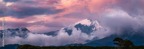 Plexiglas Lavendel Snow capped mountains in Tuscany, Apuan Alps at sunset.