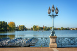 Old vintage street lamp on the lake of Enghien les Bains near Paris, France - 193946109