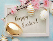 easter greeting card. photo frame with easter eggs and flowers