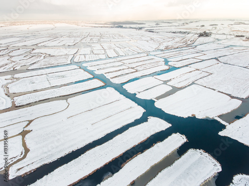 Amsterdam Aerial view of marshland covered with snow.