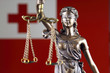 Quadro Symbol of law and justice with Tonga Flag. Close up.