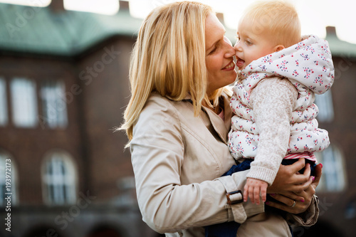 Happy family moments of mom and toddler. Childhood and motherhood care.