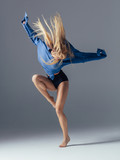 Young beautiful female dancer is posing in the studio - 193977915