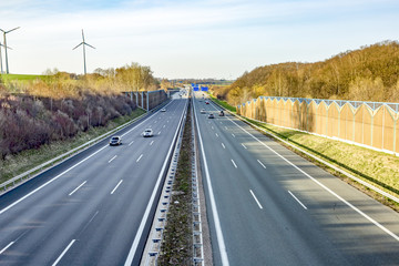 Highway with noise barriers