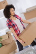 woman moving in carrying cartons boxes