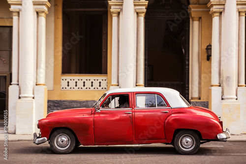 Keuken foto achterwand Havana Old classic car parked on a street in old Havana