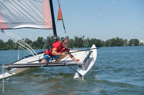 Aluminium Zeilen man sailing with sails out on a sunny day