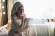 woman in a house dressing gown and with a towel