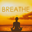 Leinwanddruck Bild - BREATHE yoga inspirational title on sunset beach background woman meditating in lotus pose yoga meditation at sunset. Word breathe written on copy space for motivation in health and fitness concepts.