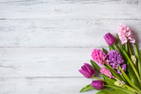 Wooden background with a bouquet of spring flowers tulips and hyacinths - 194049182